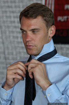 Manuel Neuer. Getting dressed, one handsome side-eye at a time.