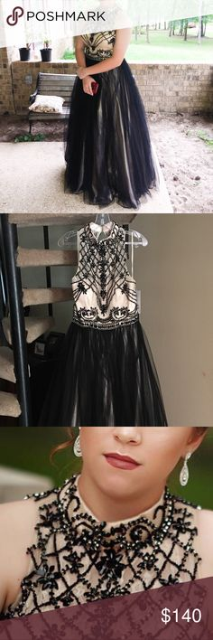 """Black and nude, halter top, A-line prom dress. Black and nude, halter top, A-line prom dress. Layers of black tulle cover nude underlay. Top is nude lace and beaded in intricate patterns using black and silver beads. Size is 12, but fits more like a 10. No alterations were needed or done. Girl is 5'5"""" in 3"""" inch heels. Worn once and has been stored in a protective bag since. Dresses Prom"""