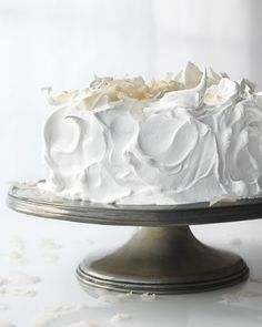 Raspberry White Cake - Martha Stewart RecipesRaspberry White Cake This cake is made with cream for a luxuriously rich texture. Cut through the fluffy meringue frosting to reveal the raspberry-flecked cake layers with raspberry jam in between. Food Cakes, Cupcake Cakes, Cake Icing, Frosting Recipes, Cake Recipes, Dessert Recipes, Dessert Healthy, Meringue Frosting, White Frosting