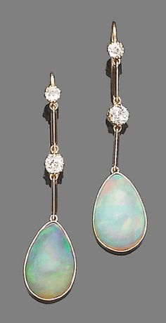 A pair of opal and diamond earrings Each collet-set pear-shaped cabochon opal, suspended from an old brilliant-cut diamond and knife-edge bar line surmount, diamonds approx. 0.50ct. total, length 4.9cm. #DiamondEarrings