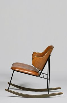 sold by Case Antiques. Kofod Larsen Penguin Rocking Chair