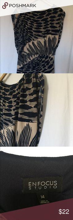 Women's dress for sale! Navy blue and tan dress. Dress falls right above knee. Elastic waistband at hip. En Focus Dresses Mini