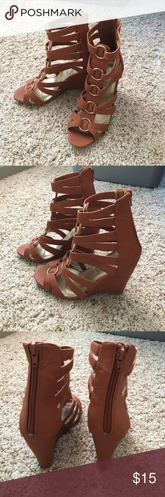 """Gladiator Wedge Sandal Heels These are cute wedges and worn once. They're too big for me. I only bought then because they were so cute! Lol. They are from Rue21 so if you know anything about their shoe sizing, it's a little different. The sizing is labeled M 7/8. I included a size chart from the site to help. These are a lovely cognac brown color with gold accents going down the front. Wedge height is approx 4"""". The gladiator style is so cute! Open to fair offers and no trades! Rue 21 Shoes…"""