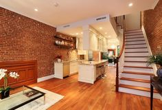 """Kitchen in the """"hallway.""""  Traditional Kitchen with Breakfast bar, Crown molding, Flat panel cabinets, Brellin Cabinet Door Style By Aristokraft, Flush"""