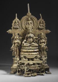 The Buddhist Goddess Shyama Tara (Green Tara) Attended by Sita Tara (White Tara) and Bhrikuti Attributed to Kumaradeva (India, active 8th century) India, Madhya Pradesh, Sirpur, circa 8th century Sculpture Copper alloy inlaid with silver 15 x 10 1/8 x 7 in. (38.1 x 25.71 x 17.78 cm) From the Nasli and Alice Heeramaneck Collection, Museum Associates Purchase (M.84.32.1a-d) South and Southeast Asian Art