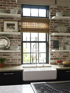 KITCHEN: After looking at lots of designs, this is my ideal. I love the brick wall, only I would mirror the style in the living room fireplace. Farmhouse sink is a must, and I LOVE the open shelves, but may want to make it a bit more industrial by adding old pipe instead of leaving them floating.
