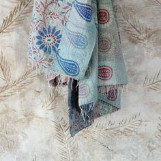 Vintage Kantha Throw (Blues)    Upcycled from traditional Sari's, these exquisite Kantha Throws have been hand-stitched to perfection by talented female artisans. This process gives each piece an antique handworked feel and is great for snuggling up on the sofa.