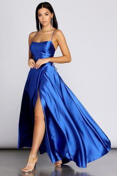 Stun in stylish satin as you captivate in our Anne dress! She features a vibrant hue, a square neckline, narrow straps that lead to a bold lattice back and a flattering empire waist accent. Her slim fit bodice leads to a show stopping voluminous ball gown silhouette that is accented with hidden side pockets. Stunning Prom Dresses, Pretty Prom Dresses, Hoco Dresses, Satin Dresses, Cute Dresses, Strapless Dress Formal, Beautiful Dresses, Long Formal Dresses, Blue Satin Dress