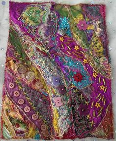 Purple fabric collage by Judith McCarthy.