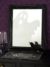 Ghost in the Mirror Halloween Craft  Create this frightening Halloween sight in a flash by spraying a ghost shape onto a mirror.