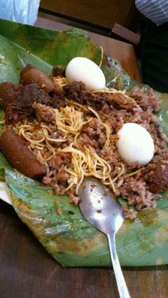 Waakye, Wele, Tamago, Sakana with Shito - Ghanaian dish served in a leaf - (the bigger the gutter by the spot the better the waakye) direct correlation Ghanaian Food, Nigerian Food, Around The World Food, West African Food, Exotic Food, Caribbean Recipes, Cooking Recipes, Healthy Recipes, I Love Food