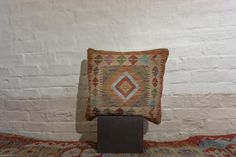 Hand Made Mazar Kilim Cushion from Afghanistan. Length: 50.0cm by Width: 50.0cm. Only £49 at https://www.olneyrugs.co.uk/shop/kilims-for-sale/afghan-mazar-22314.html    View our enticing collection of kilim rugs, carpets, kilim ottomans and Kilim cushion covers at www.olneyrugs.co.uk
