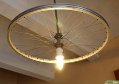 How to Make a Bike Wheel Chandelier. Do you have an old bicycle rim hanging around your house? Are you a bike enthusiast looking for a new décor for your ceiling? Why not make a chandelier from an old bike rim? Find an old bike rim. Bicycle Decor, Bicycle Rims, Old Bicycle, Bicycle Wheel, Old Bikes, Bike Wheels, Bicycle Crafts, Bicycle Design, Wheel Chandelier