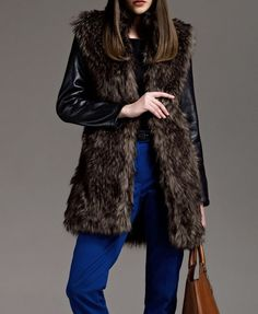 Faux Fur Coat. Combining my 2 favorite things..fur and leather. If only she was wearing red pants.