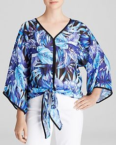 With a bright blue and purple palette, kimono sleeves and tie front detail, Status by Chenault's printed top pairs well with crisp white pants or high-waisted jeans. #100PercentBloomies
