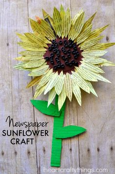 This painted newspaper sunflower craft is perfect for a summer kids craft. Watercolor painted newspaper brings great texture and vibrant colors to crafts. Pretty flower craft for kids, recycled craft for kids, newspaper craft.