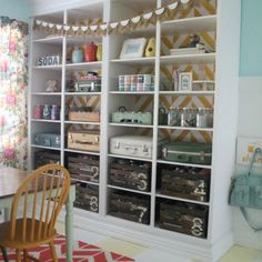 A bright and cheery craft room, packed with organization ideas using vintage suitcases and DIY crates!