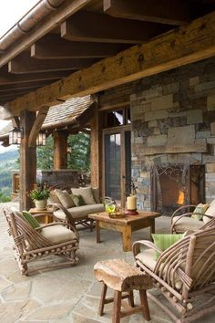 We love everything about this rustic outdoor space.  From the natural stone on the ground to the masonary natural stone work on the fireplace, this space can easily transform your backyard to an outdoor vacation at home.