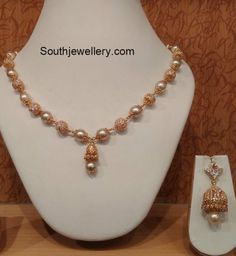 22 carat gold simple mala strung with south sea pearls and cz balls paired with cz jhumkas from Naj jewellery. Pearl Necklace Designs, Beaded Jewelry Designs, Gold Earrings Designs, Gold Jewellery Design, Pearl Jewelry, Pendant Jewelry, Gold Designs, Chain Jewelry, Designer Jewelry