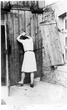 Siauliai, Lithuania, A female partisan before her execution.
