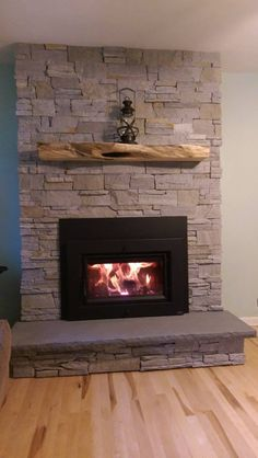 Browse our ideas for fireplace designs, mantels, fireplace surrounds, stonework and more to find inspiration for your own fireplace. Fireplace Surrounds, Fireplace Design, Insert Stove, Wood Insert, Fireplace Remodel, Mantle, Fireplaces, Regency, Design Inspiration