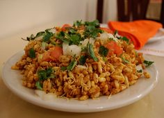 Bhel Puri recipe. Bhelpuri is a puffed rice and potatoes dish usually served with tamarind sauce. It is a popular roadside snack. Posted by Fatima.