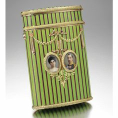 GRAND DUCHESS ELENA VLADIMIROVNA AND PRINCE NICHOLAS OF GREECE AND DENMARK: A FABERGÉ ENAMEL DOUBLE PORTRAIT CIGARETTE CASE WITH TWO-COLOUR GOLD MOUNTS, C. 1902.  SOLD. 577,250 GBP    the surface enamelled in opaque green and mauve alternating stripes, the front applied with portrait miniatures of Grand Duchess Elena Vladimirovna and Prince Nicholas of Greece and Denmark, rose-cut diamond thumbpiece.  From the Romanov Heirloom sale at Sotheby's.