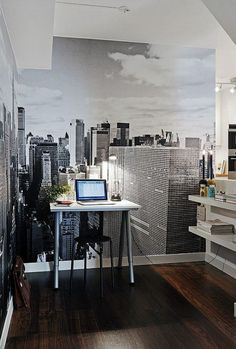 ∞ A Workspace with Gravitas: There's something excellent about that backdrop/poster. Via Amy Philly.