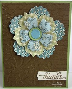 lovely handmadef the card with layered die cut flower ... luv the soft colors of patterned paper ... brown top layer has the look of embossed leather ... Stampin' Up!
