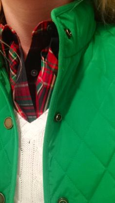 Plaid blouse - check, green quilted jacket/vest - check, v-neck cable knit sweater - check.