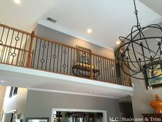 After the iron baluster upgrade from M.C.Staircase & Trim. Removal of wooden balusters and installation of alternating Single and Double Rings with Plain Bars in Satin Black.