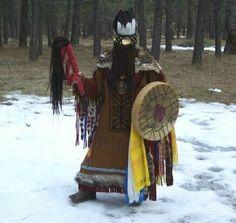 shaman with drum and minaa