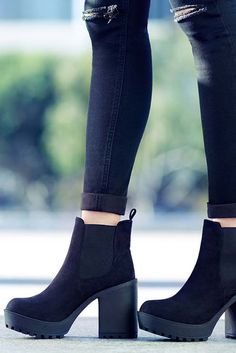 Show off your boots by rolling up your jeans an inch above the ankle.