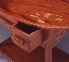 Greene and Greene Table. Dovetailing, pegs, and stunning inlay.