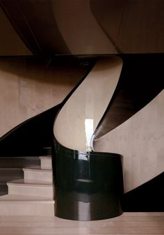 SLEEK AND SEAWORTHY  A shell-shaped staircase on fashion impresario Giorgio Armani's 213-foot yacht, Main. Photograph by Todd Eberle, November 2010