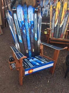 Adirondack Ski Chair with Colorado Front Board, comfort, durability and style. Made with recycled skis and hand painted with oil, we use Douglas fir bases. #adirondackstyleoutdoorfurniture