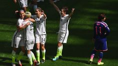 Lauren Holiday of USA celebrates with team mates after scoring
