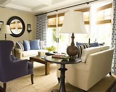 blue & tan living room design - blue couches and tan pillows/accessories. black dog doesn't go well with light  tan couch!