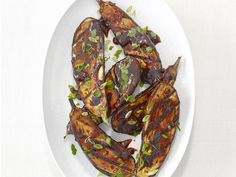 Glaze eggplant in a mixture of hoisin--a sweet and savory Asian dipping sauce--rice vinegar and hot chili sauce before tossing on the grill for a tangy summer side.