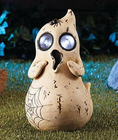 """Halloween Solar Garden Statue Ghost. Halloween Prop, Garden Statue. It has its own solar panel to collect sunlight. Powered by the sun (solar). A fun Halloween decoration that withstands the weather in the garden, outdoors or inside the home. Cold cast ceramic. A Fun-filled Halloween ghost prop. Color: Cream. It's powered by the sun so it doesn't need an electrical outlet-put it in any sunny spot to charge. Large solar powered eyes for lights. Ghost measures 14. x 7-1/2. x 7""""."""