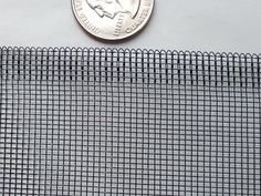 A coin besides black powder coated aluminum screen for contrast, and show the details of edge. Aluminum Screen, Security Screen, Aluminium Windows, Window Screens, Mesh Screen, How To Attract Customers, Wooden Case, Aluminium Alloy, Windows And Doors