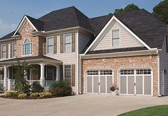 Garage doors. GRAND HARBOR® COLLECTION steel and composite carriage house garage doors with or without insulation. Clopay.