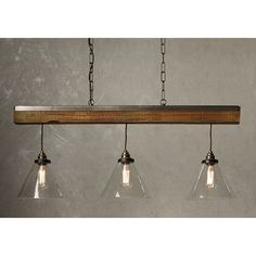 The charming Aspen multiple ceiling pendant light combines three conical shaped clear glass shades hanging on braided cord cables from a long wood effect beam. The design showcases elements of modern, vintage, and industrial styles and is perfectly suited to traditional rustic settings and would not be out of place in more contemporary settings either. A simple nostalgic look that is perfect for lighting over dining tables, breakfast bars and kitchen islands