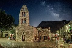 Milky way over Areopolis (Greece) by saki makedon Milky Way, Notre Dame, Medieval, Greece, Guest Houses, Building, Places, Photography, Travel