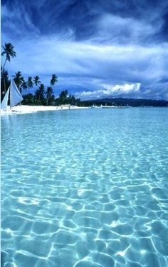 Boracay, Philippines.... Trust me it does exactly look like this.. Crystal clear water, u have to visit this island. It is mad fun and u will never regret it. Been there 4times and I haven't got tired of the place
