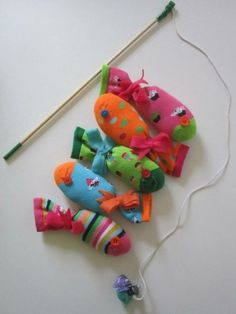Fishing game for kids using socks w/ a magnet inside and tied at the ends to make the fish.  So creative!