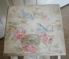 Debi Coules Bird | Close-up of Debi Coules table.
