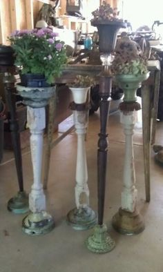 old banister spindles or table legs into plant stands