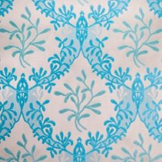 This is a synthetic blend in beige with a turquoise colored chenille classical pattern. Great for Upholstery.
