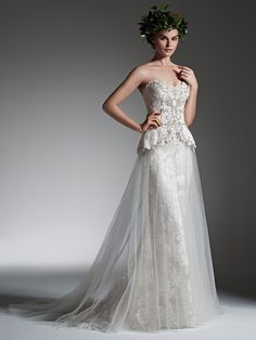 Sottero and Midgley - TABITHA, A whimsical layer of tulle overlays a slim skirt in this lace A-line wedding dress, accented with a lace peplum bodice, adorned with Swarovski crystal swirls and an opalescent pearl and crystal belt. Finished with scoop neckline and pearl buttons over zipper and inner corset closure.